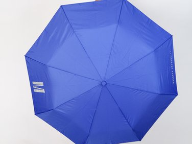 Blue folding umbrella